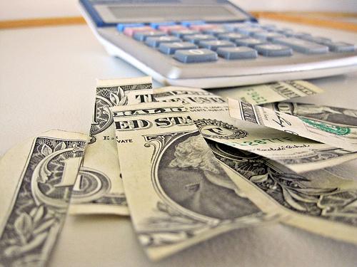 Calculator and Dollar Bill